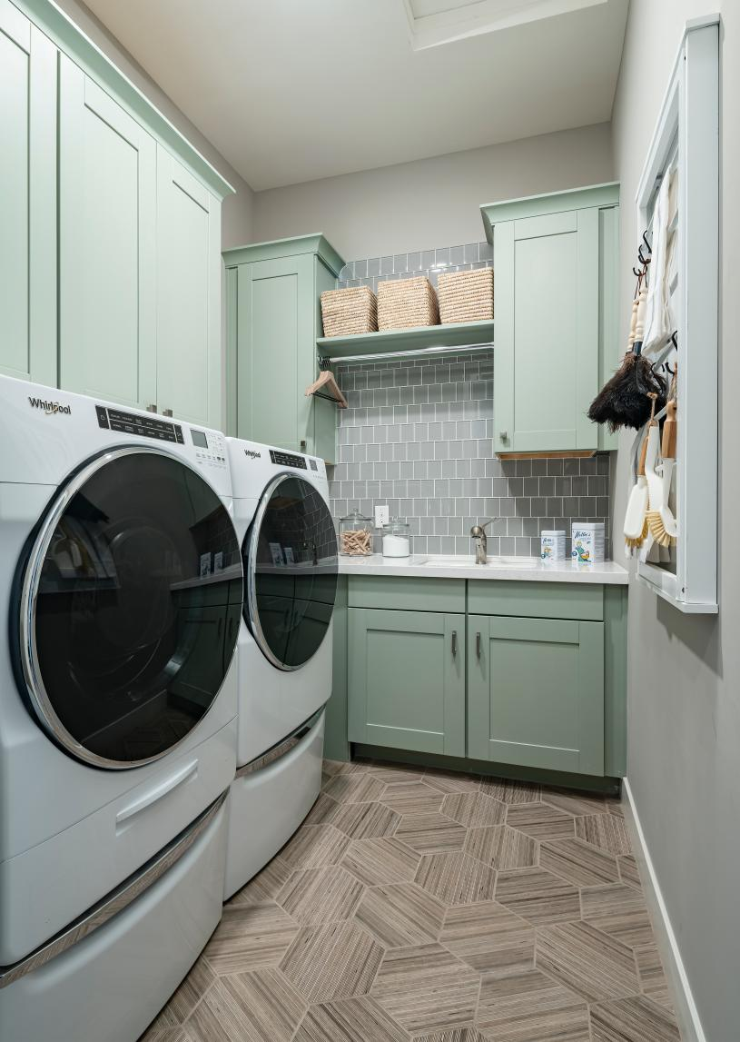 Centrally located laundry room with added sink and cabinets
