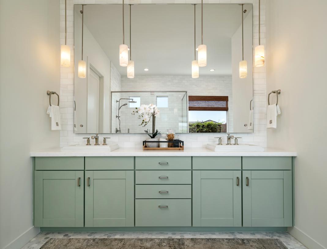 Primary bathroom features dual-sink vanity