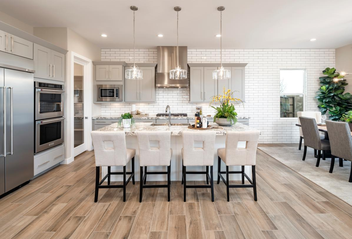 Luxurious standard features include beautiful cabinetry and countertops, and stainless steel appliances