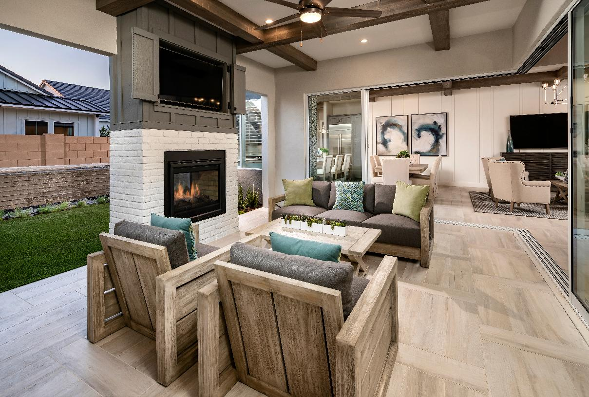 Large covered patio with fireplace provides excellent outdoor living space