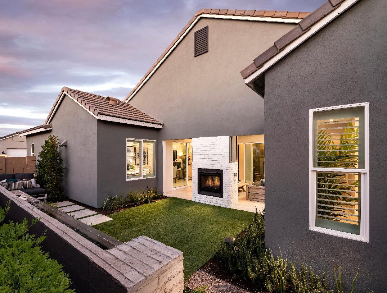 Charming backyard with dual-sided fireplace