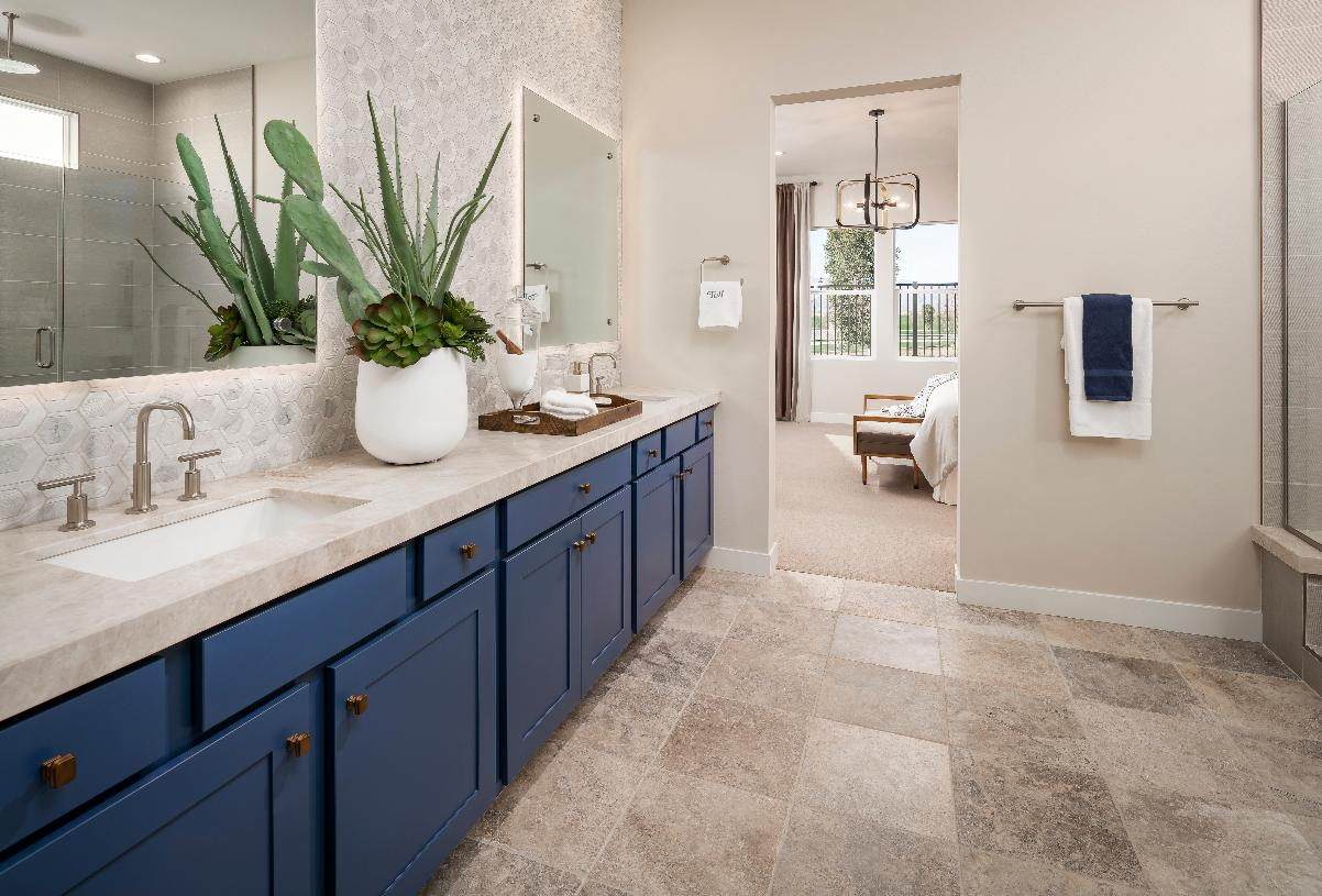 Primary bathroom with walk-in shower and tile floors