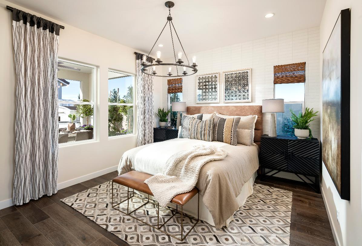 Spacious primary bedroom suite with rich wood-look tile flooring