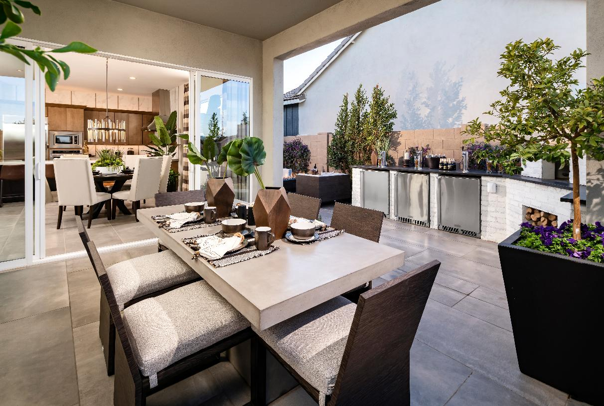 Oversized covered patio with outdoor dining space and pizza oven