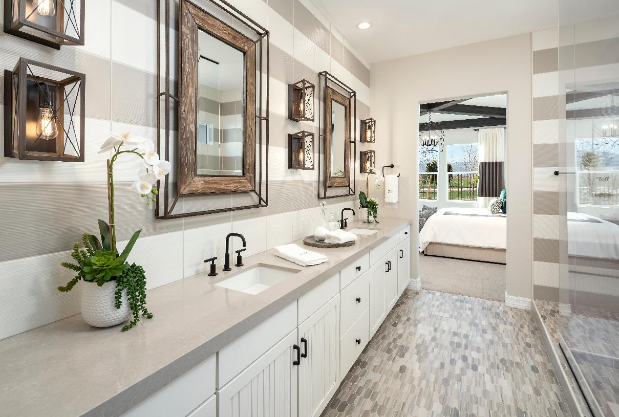 Primary bathroom with dual sink vanity and large walk-in shower