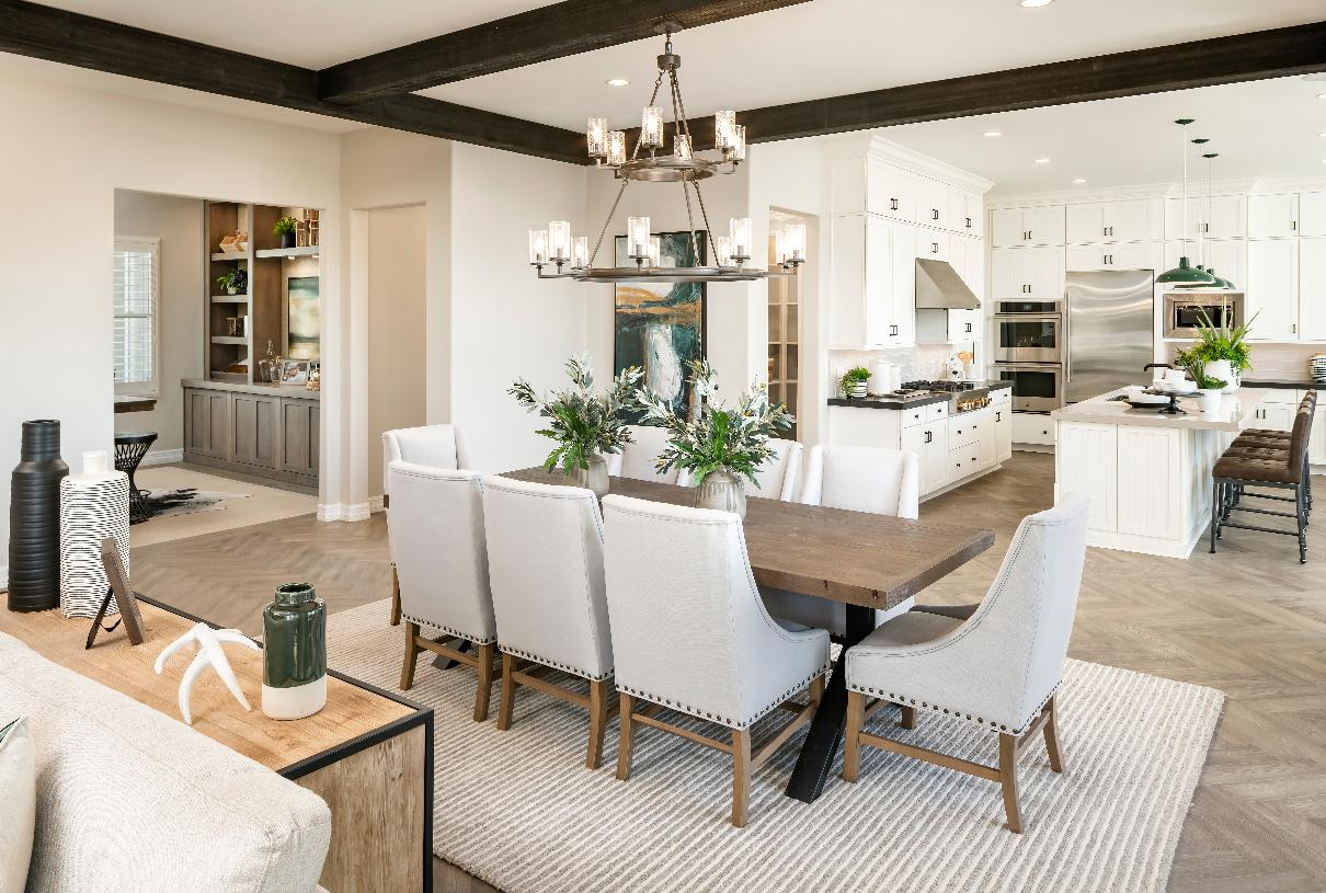 Central dining space overlooks the kitchen and great room