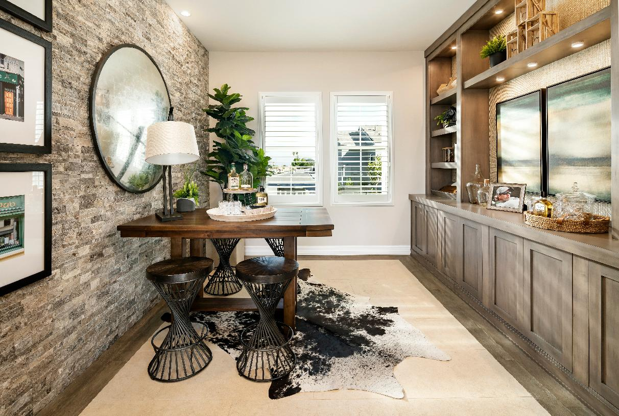 Versatile office with stone accent wall and built-in cabinetry