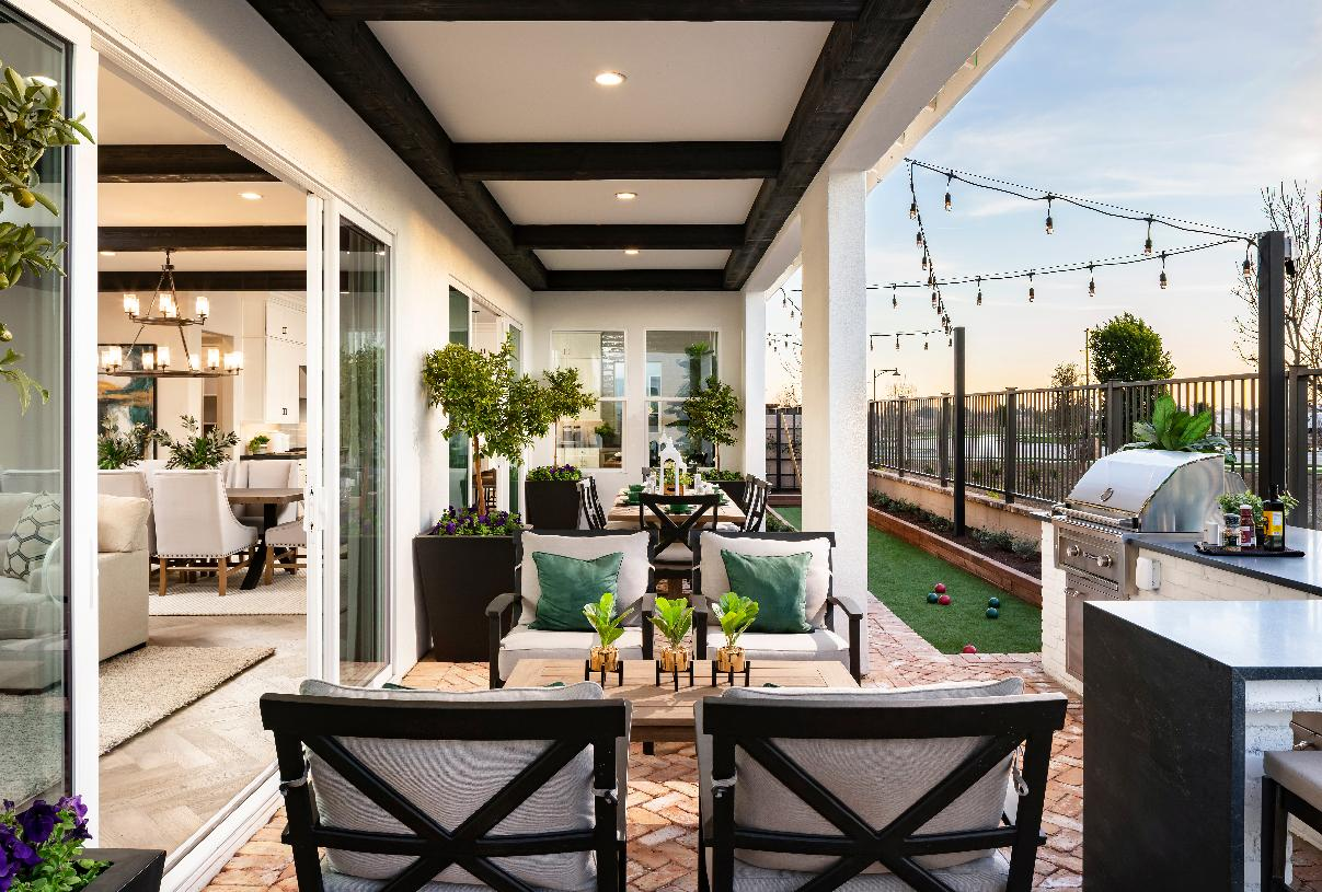 Covered patio with stacking doors and bocce ball court