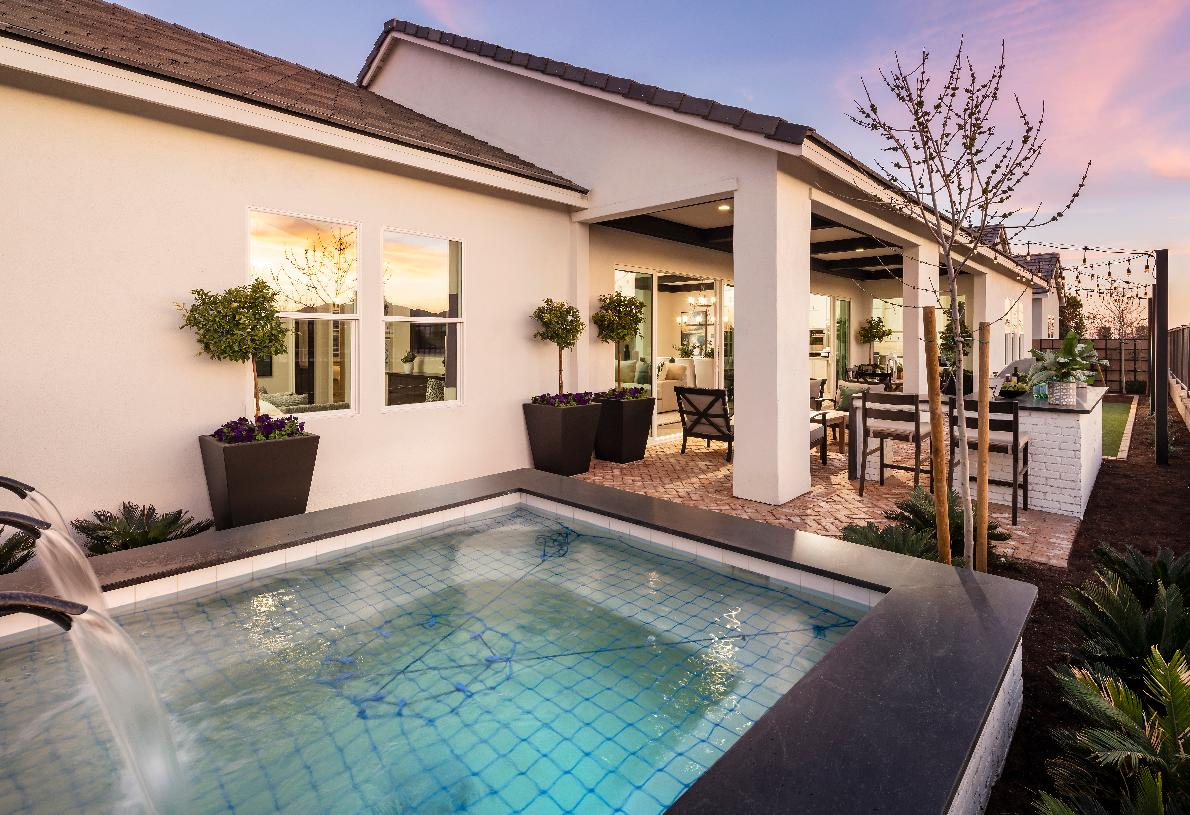Beautiful backyard with spa, outdoor dining area, and bocce ball court