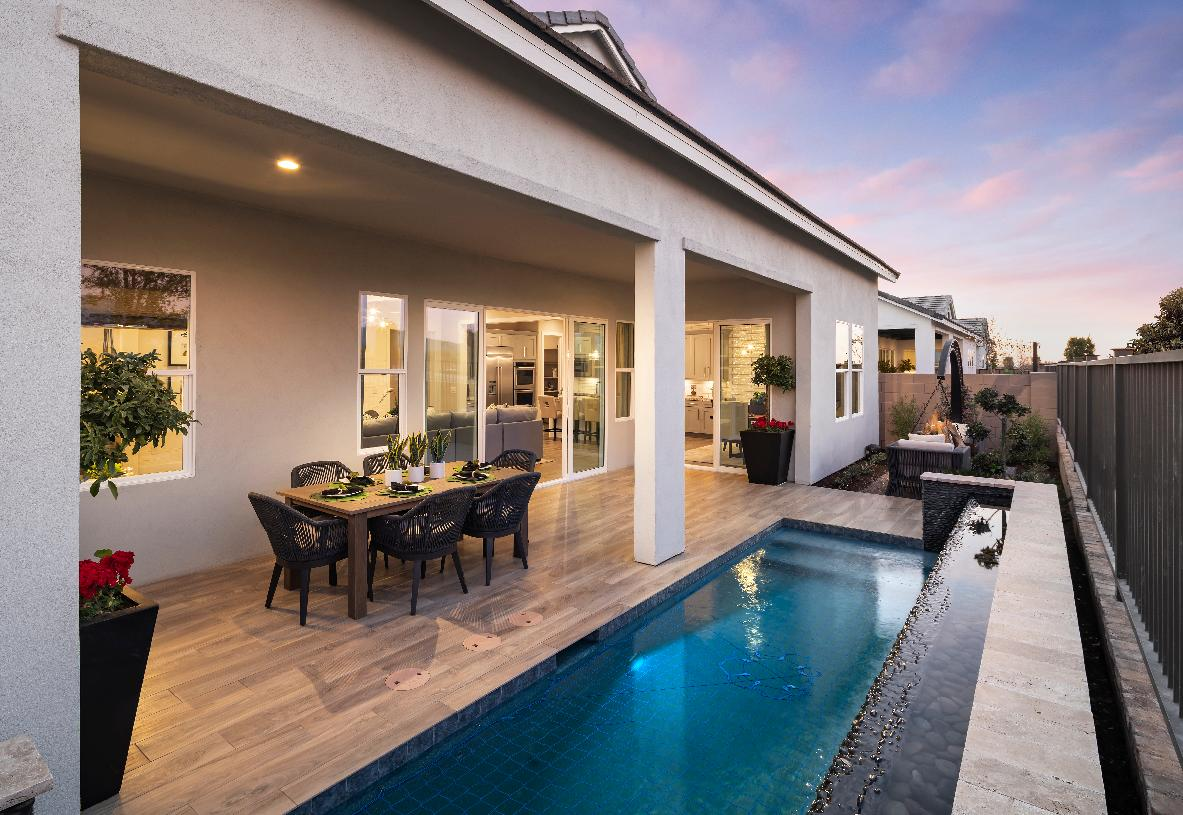 Beautiful backyard with covered patio, spa, and outdoor gathering area with firepit