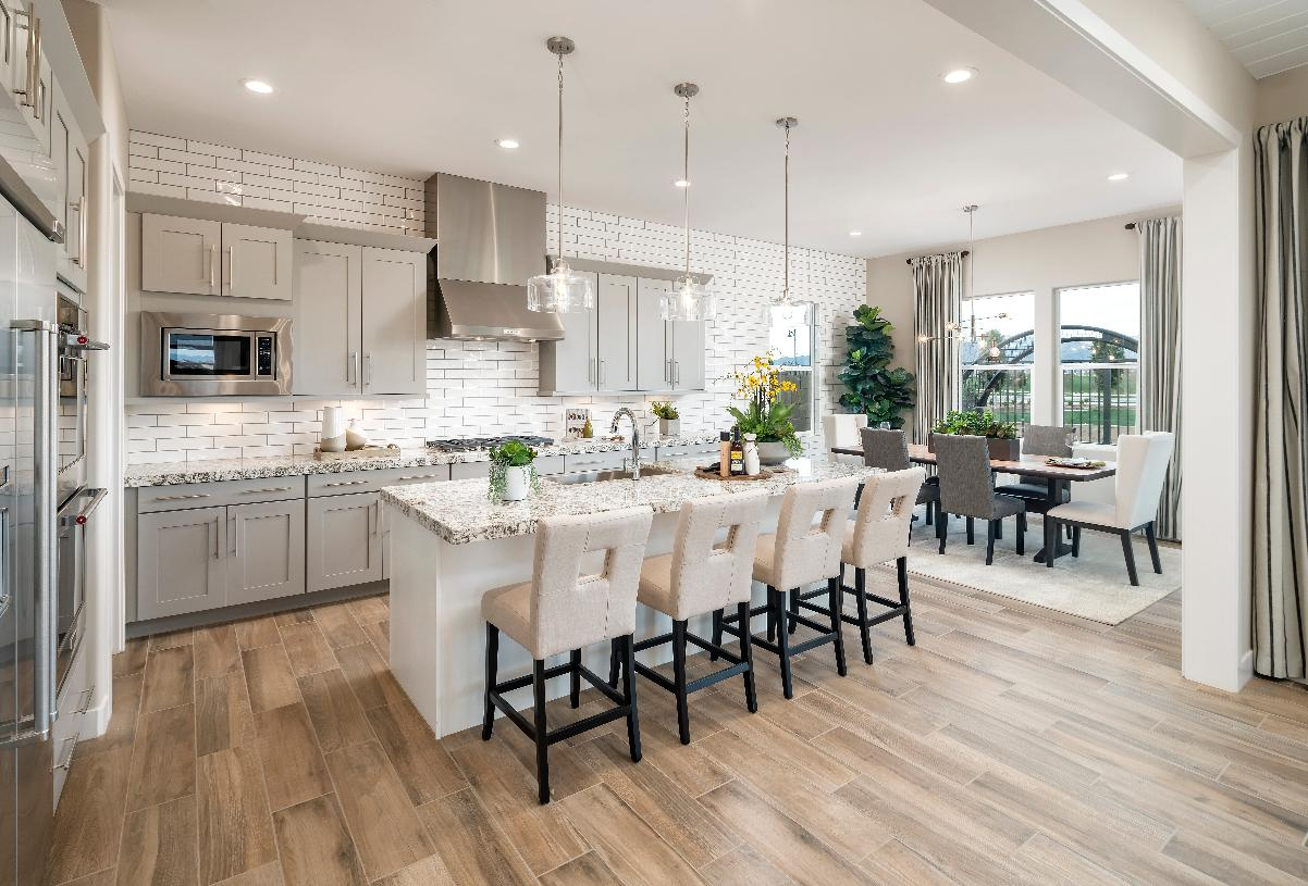 Well-appointed kitchen with adjacent casual dining space