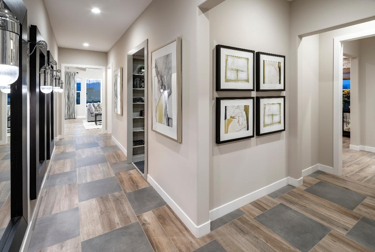 Welcoming foyers with views of the great room and covered patio beyond