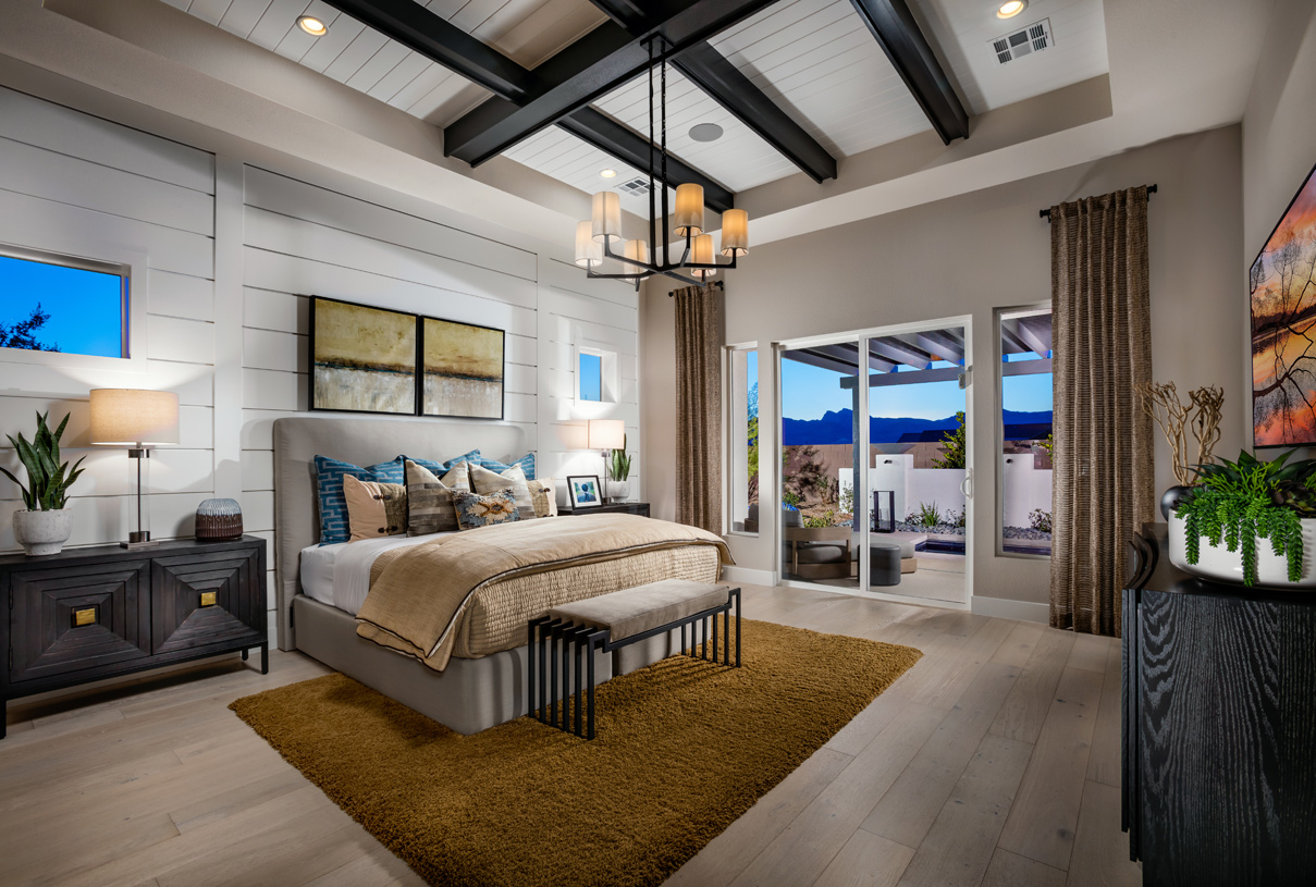 Serene primary bedroom with elevated ceiling