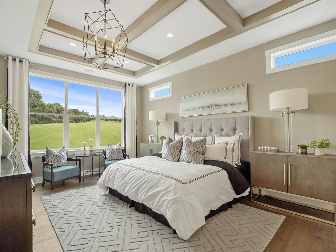 Luxurious first-floor primary bedroom suites