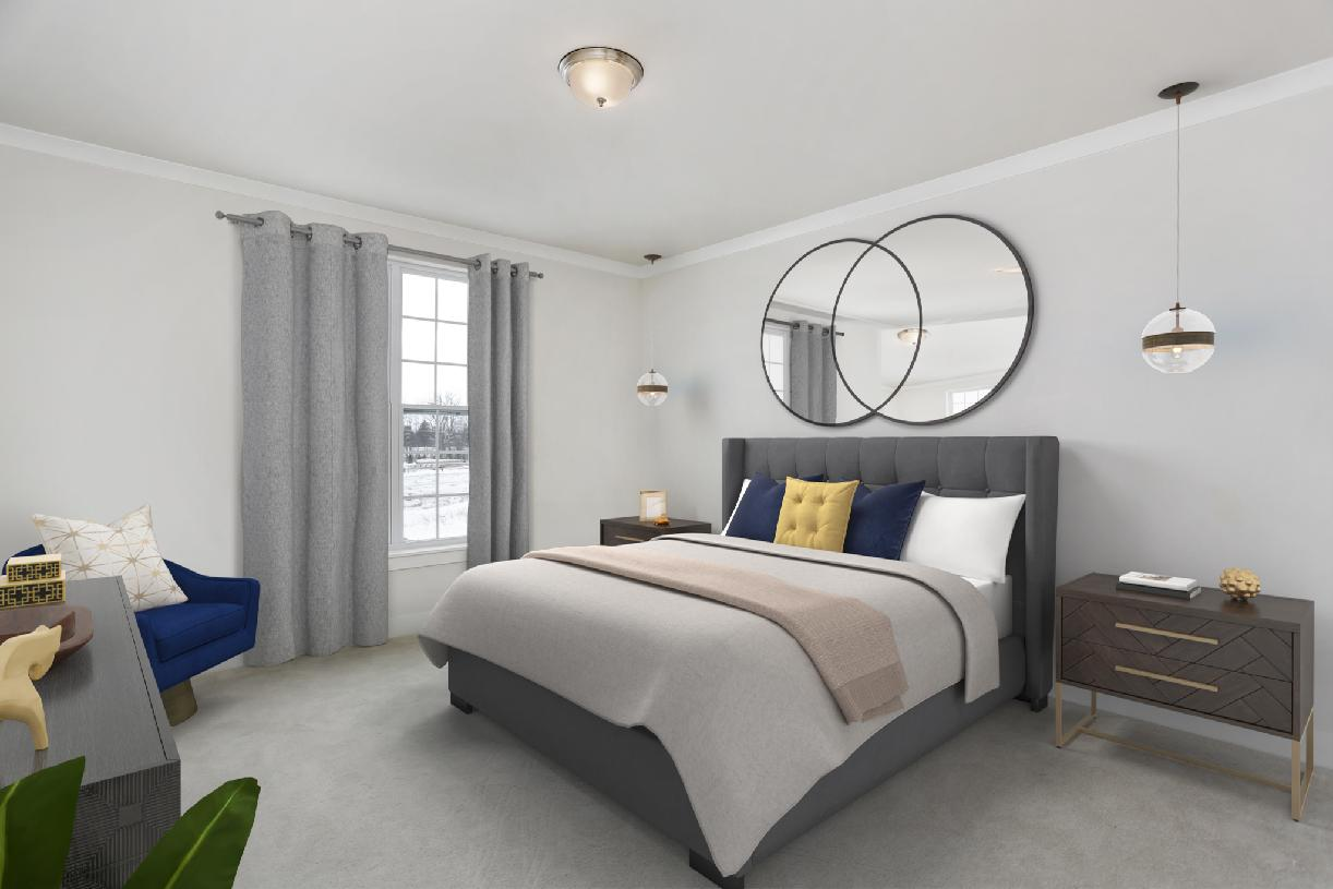 Spacious first-floor primary bedroom suite