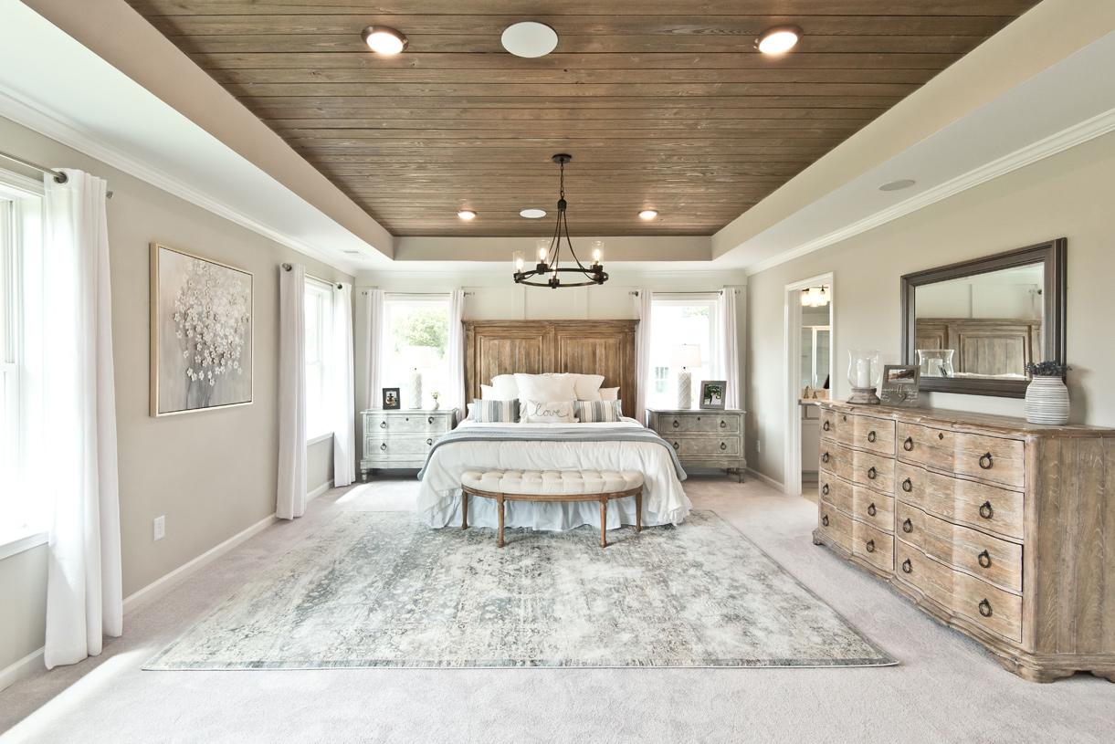 Luxurious primary bedroom suite