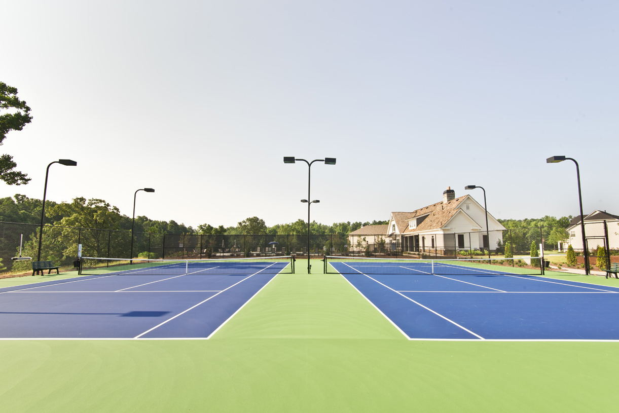 Play a match with friends on the tennis courts