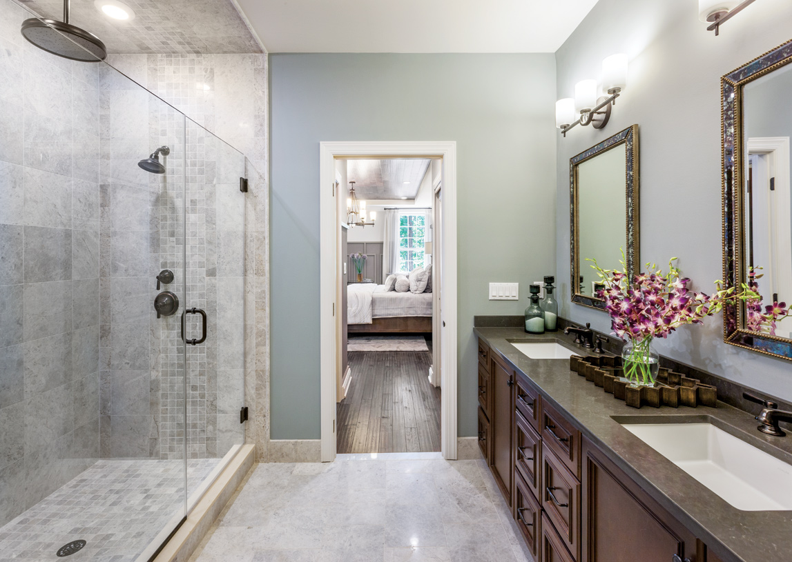 Primary bathroom with a large glass door shower