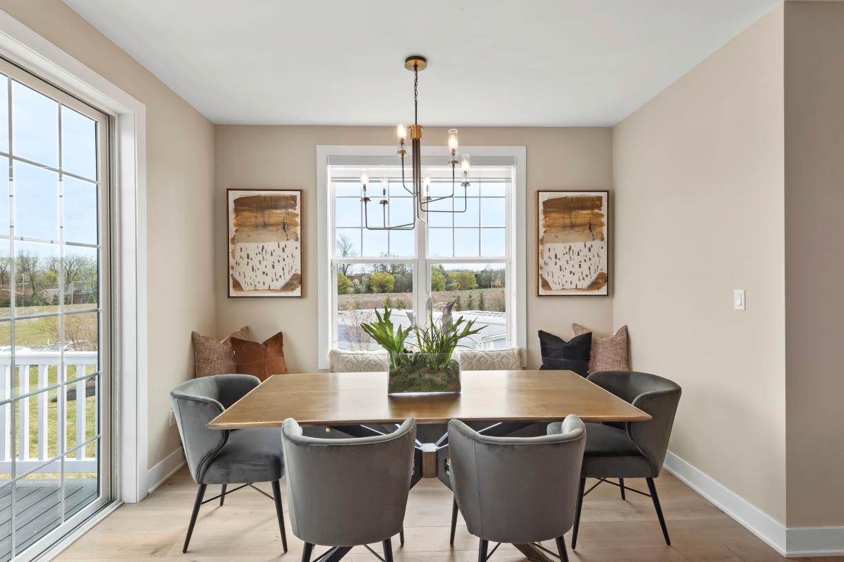 The casual dining area is adjacent to the kitchen and provides a convenient and intimate setting