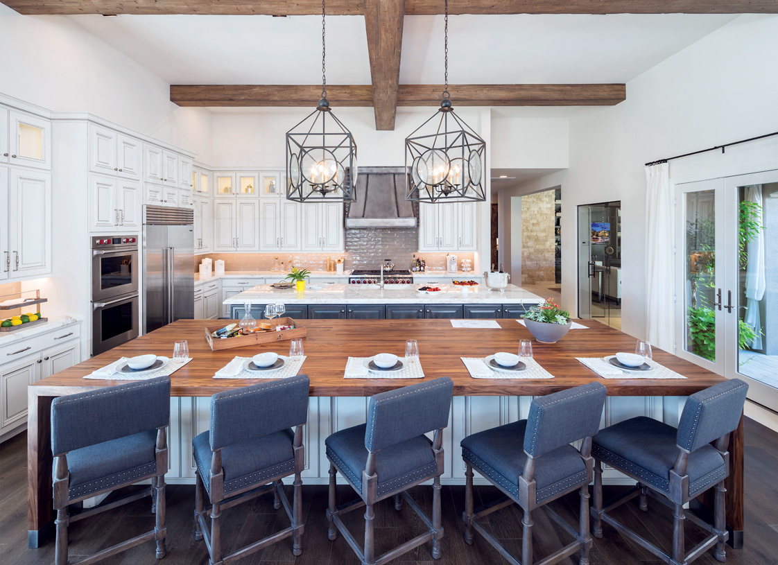 Luxurious standard features include Wolf appliances and premium cabinetry, countertops, and flooring