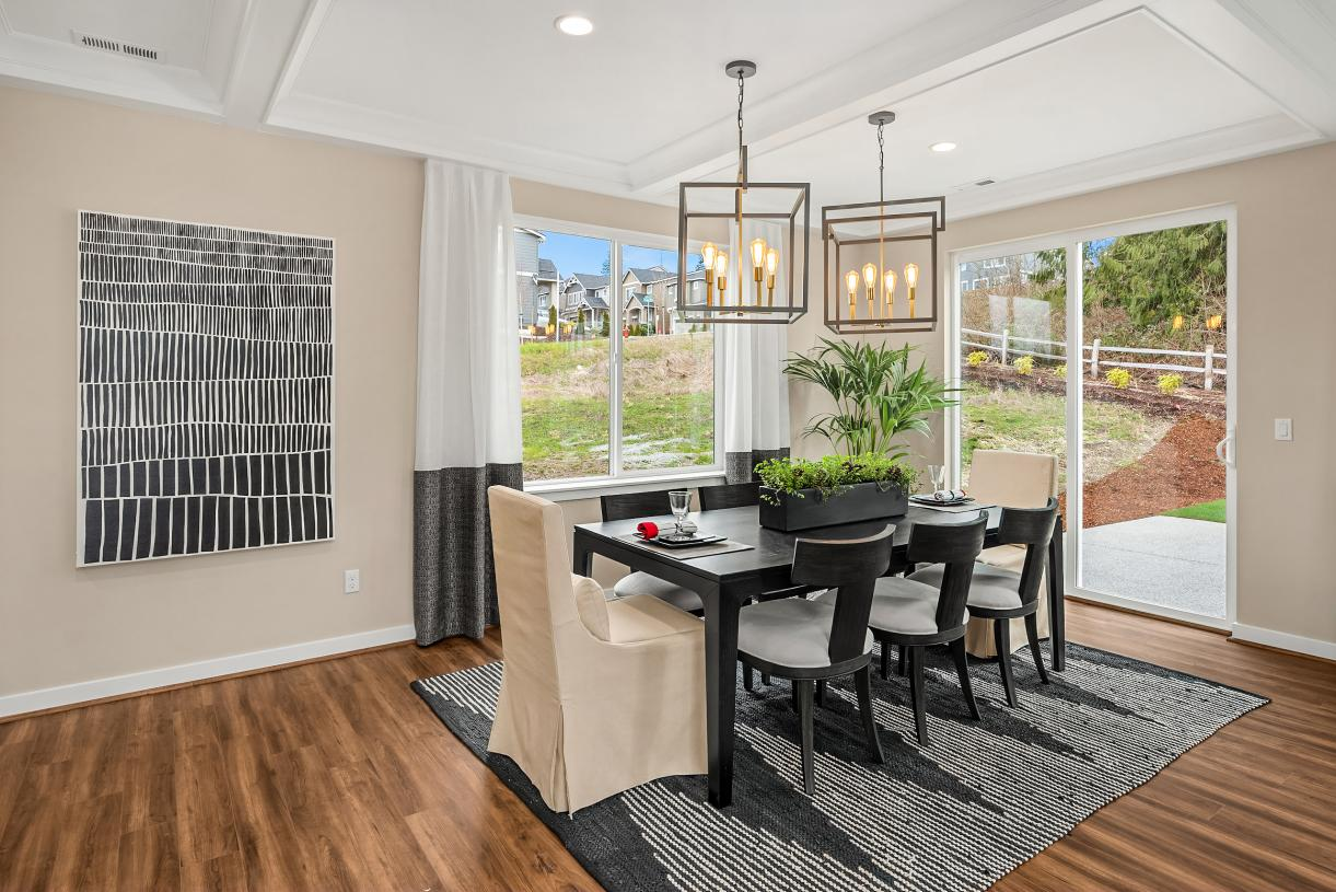 Dining area with sliding glass door to the rear patio