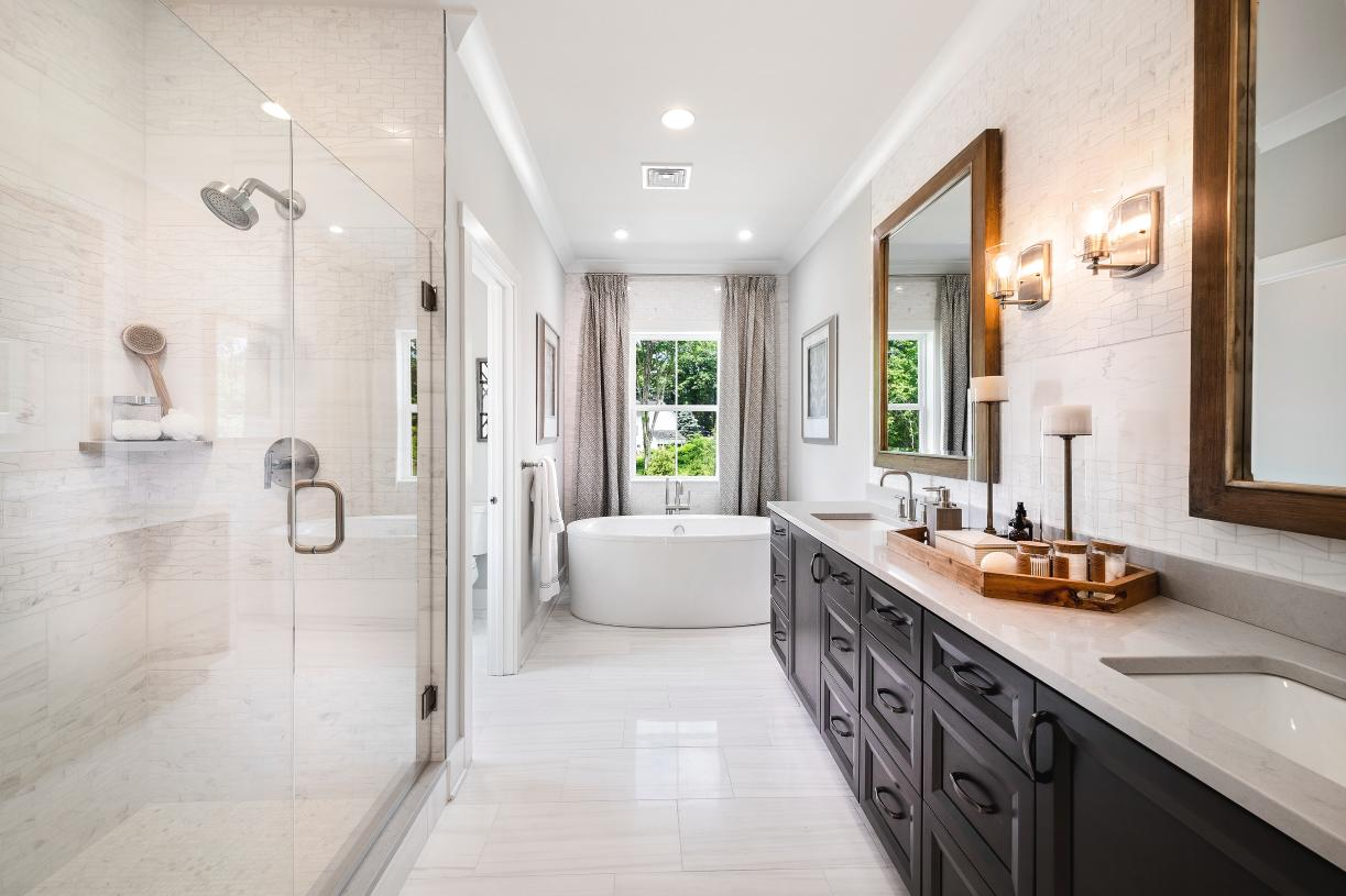 Primary bathroom suite with dual-vanity and freestanding tub