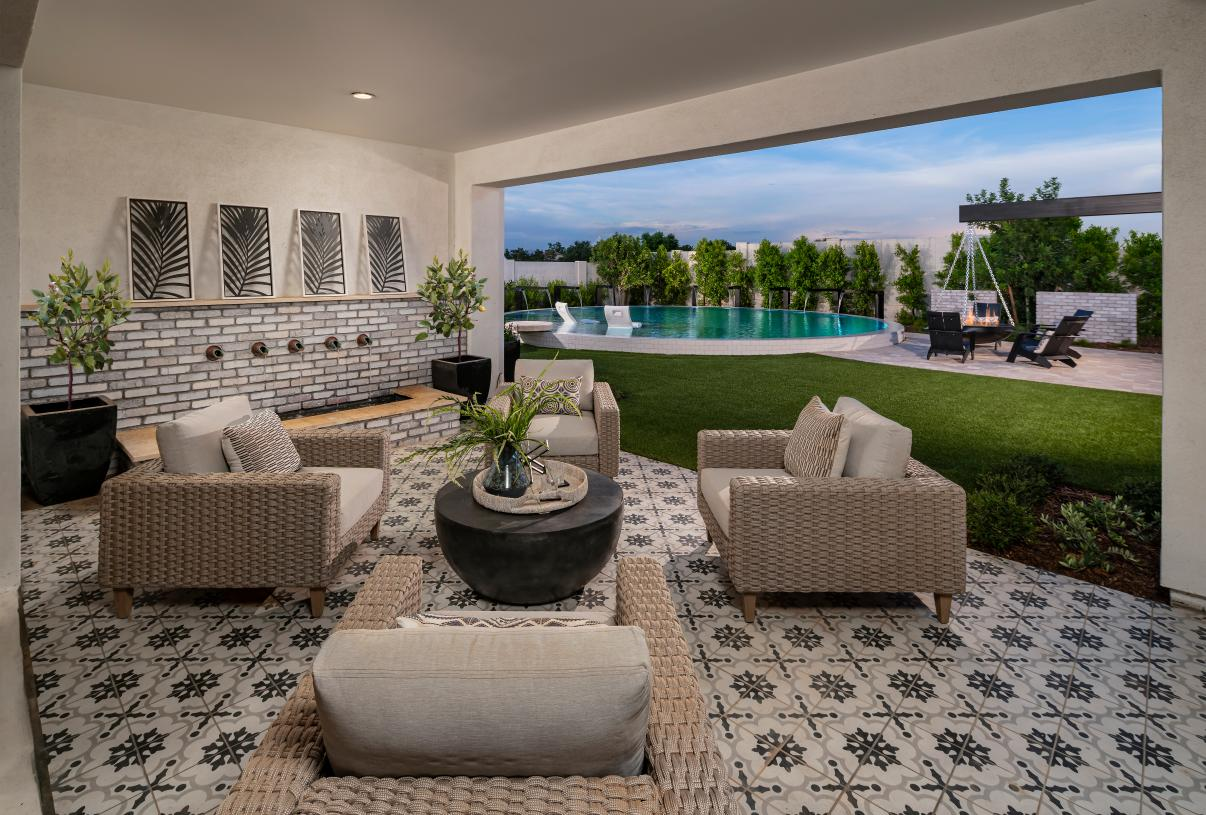Spacious rear covered patio for outdoor living and entertaining