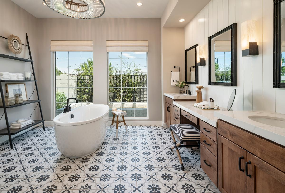 Lavish primary bathroom with large soaking tub, ample countertop and cabinet space