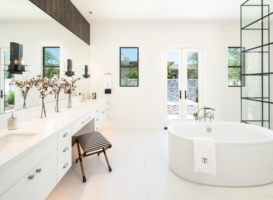 Luxurious primary baths with walk-in showers and freestanding tubs