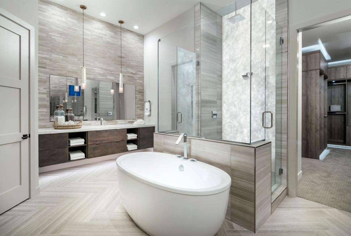 Lavish primary bathrooms with walk-in shower, and freestanding soaking tub