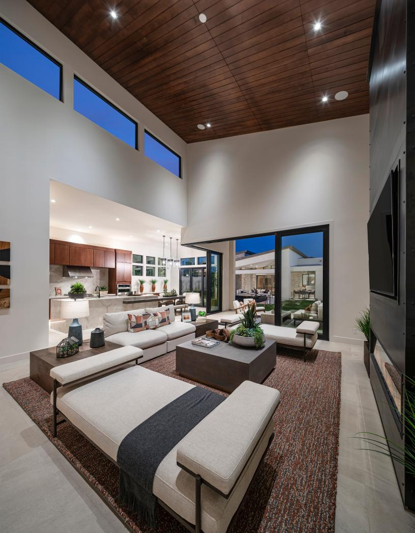 Open concept floor plans with views of the kitchen, dining area, and rear covered porch beyond