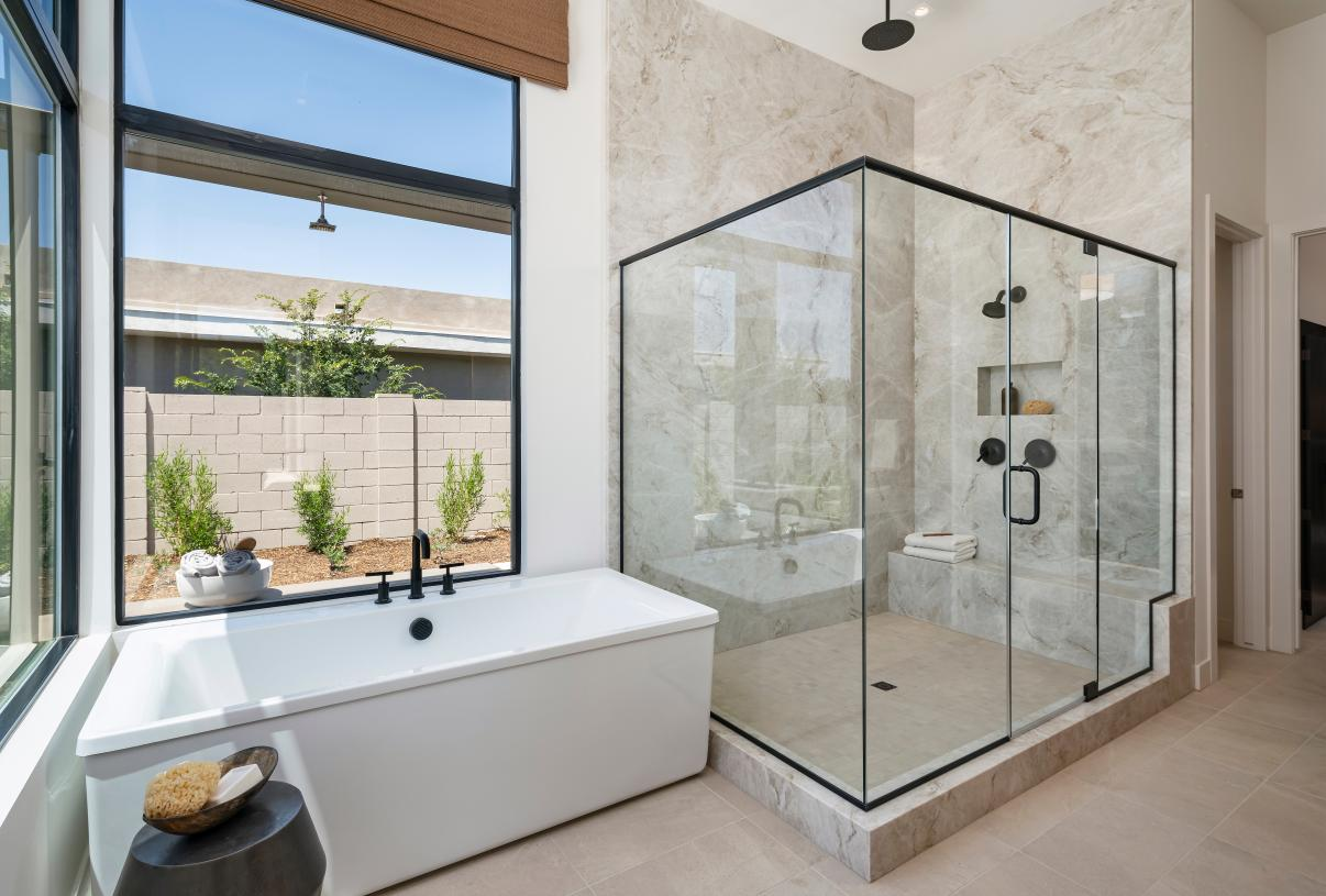 Lavish primary bathrooms with dual-sink vanities and large walk-in closet