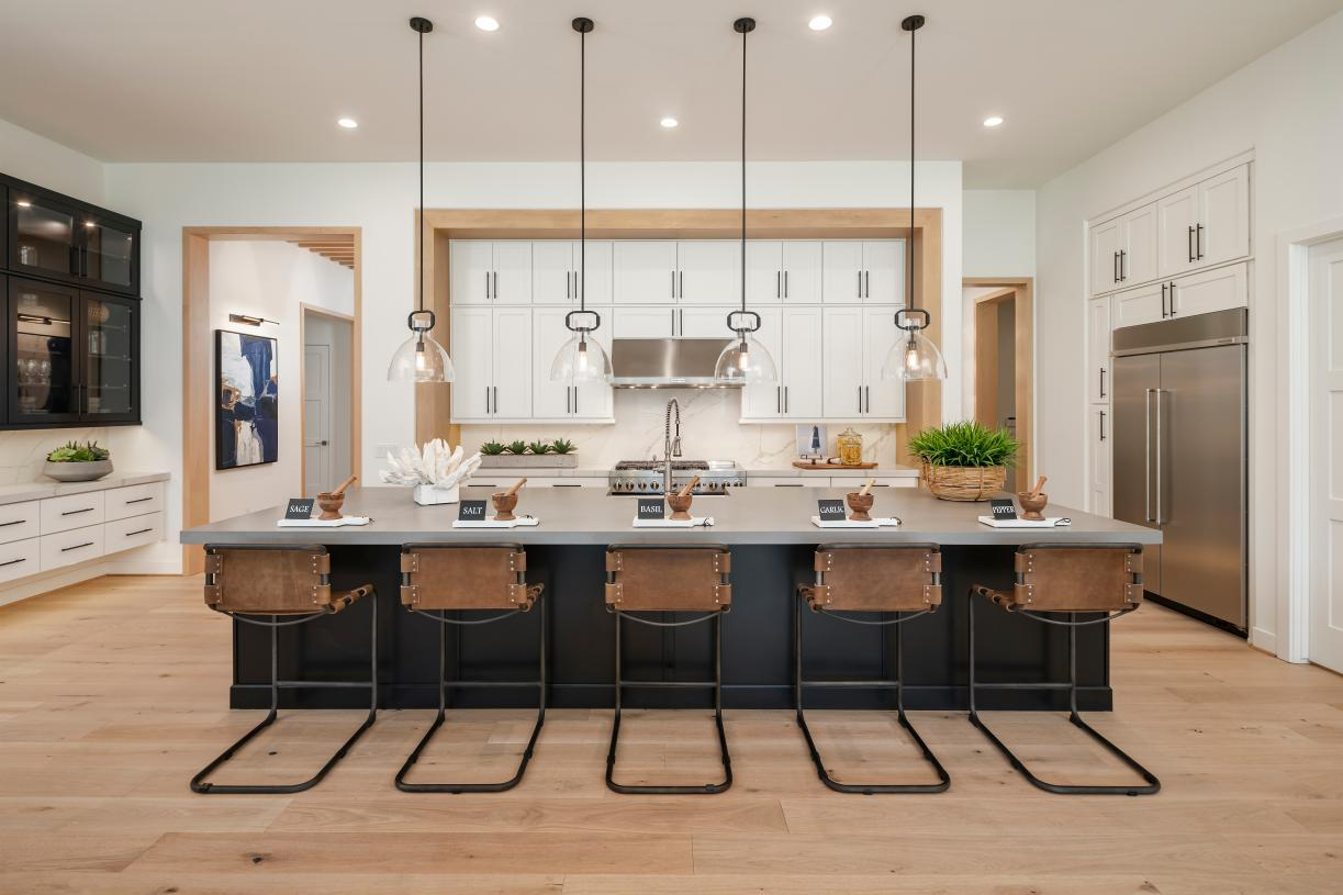 Gorgeous kitchen designs with breakfast bars, ample cabinet and countertop space