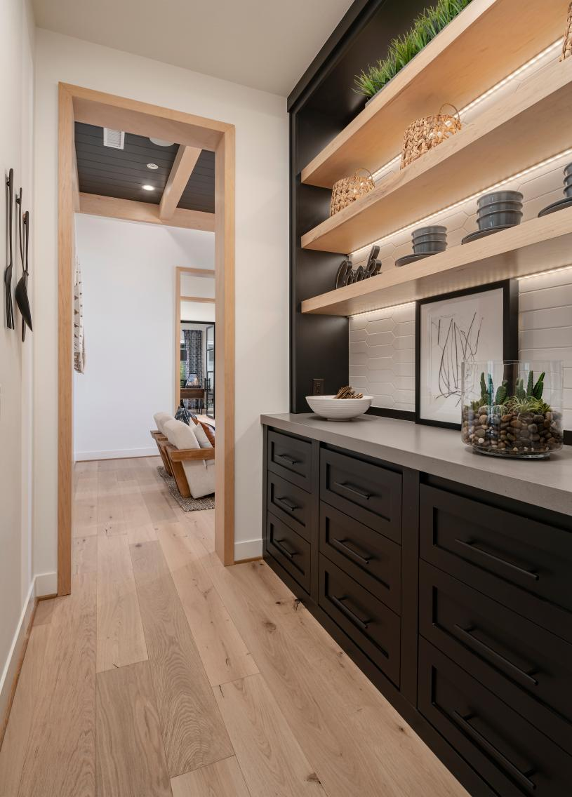 Butler's pantry ideally located off the kitchen with ample cabinet space