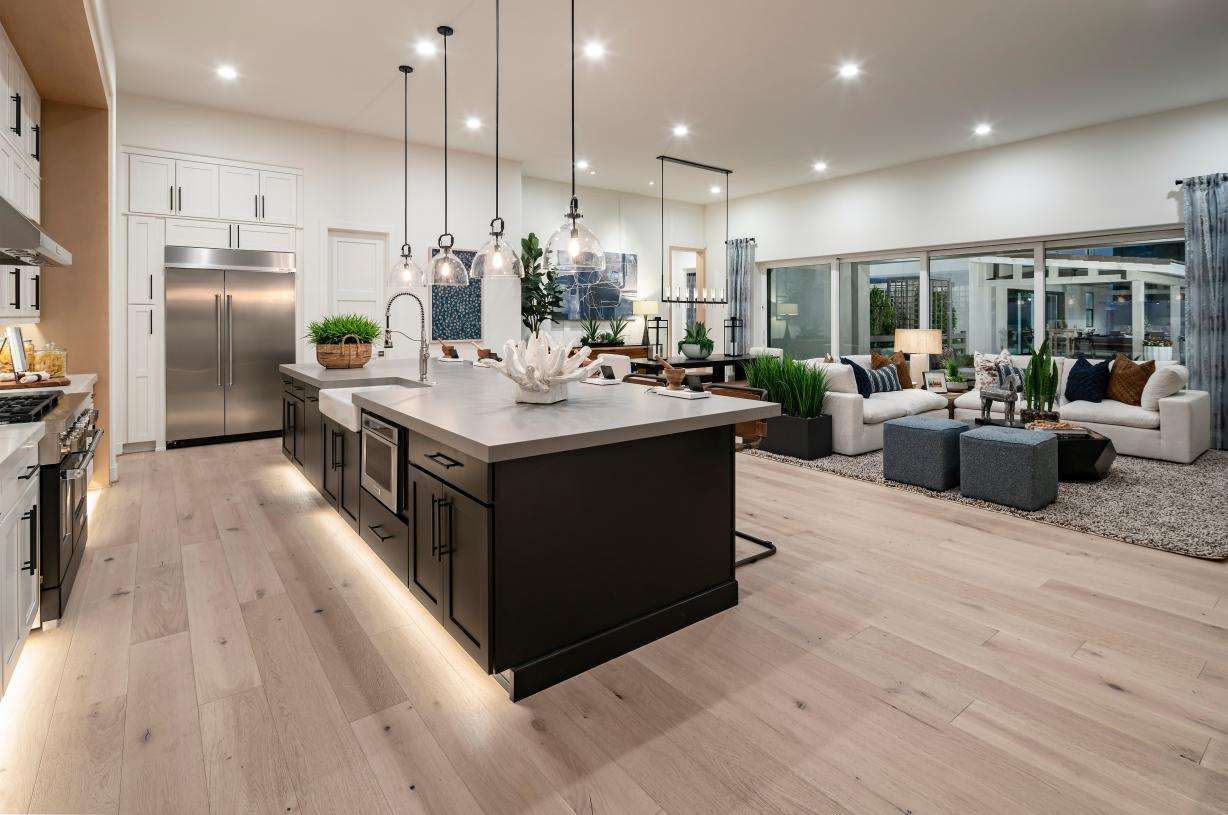 Open concept floor plan with views of the stunning great room and patio beyond