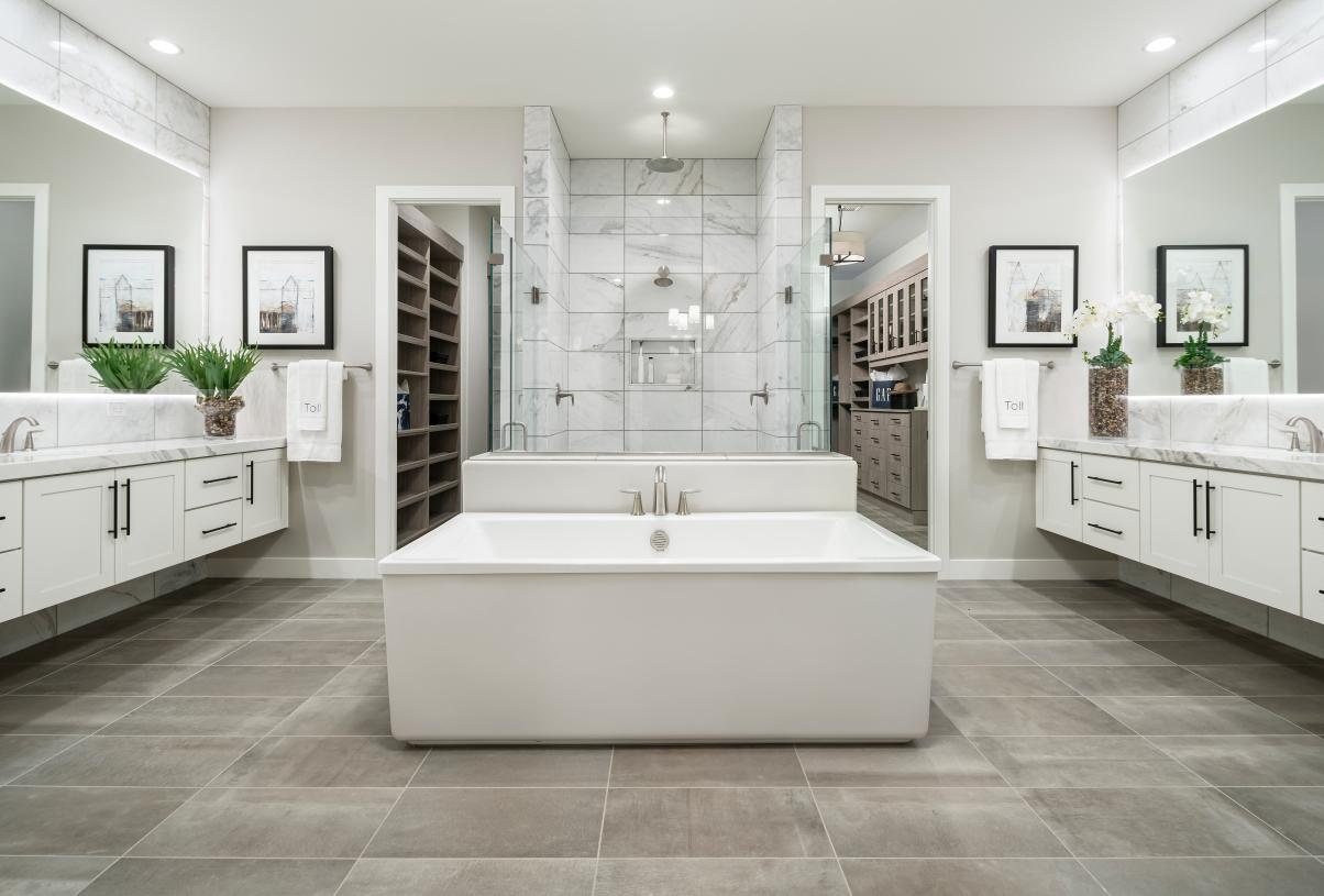 Lavish primary bath with stunning fixtures, large soaking tub, and walk-in shower