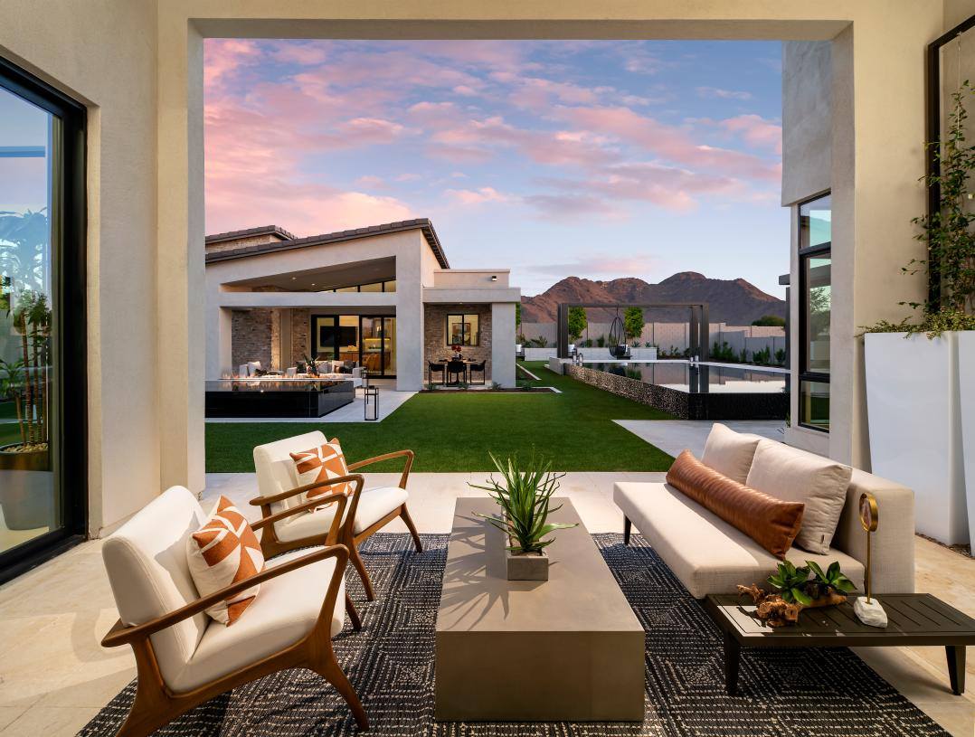 Spacious covered patio for outdoor living with views of the casita beyond