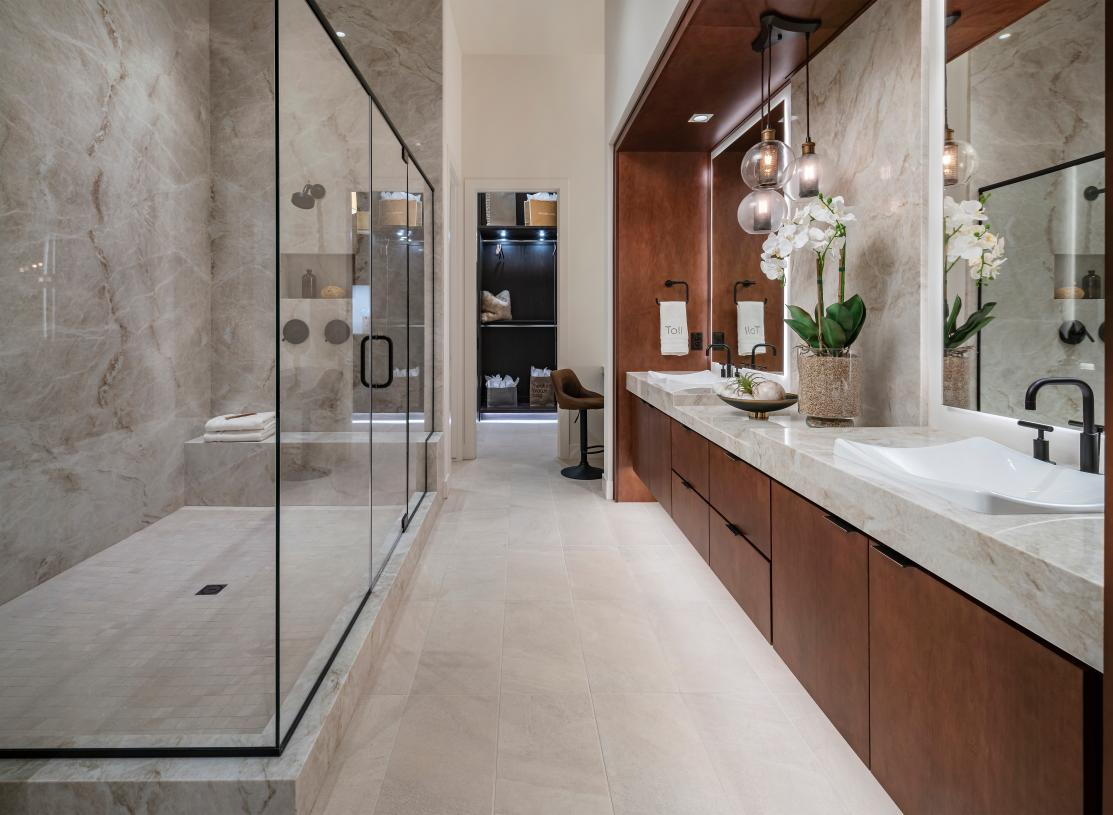 Lavish primary bathroom with huge walk-in shower and ample countertop space