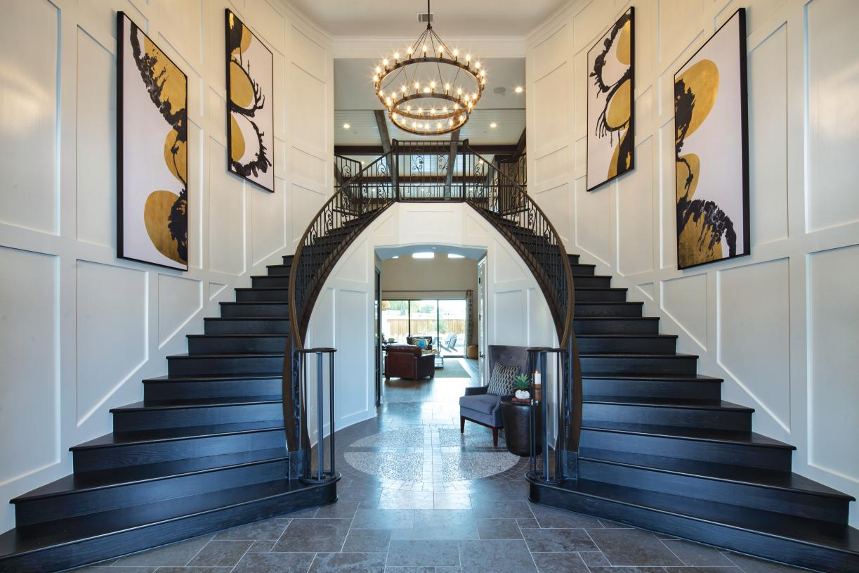 The dramatic dual-curved staircases of the Sandhaven foyer