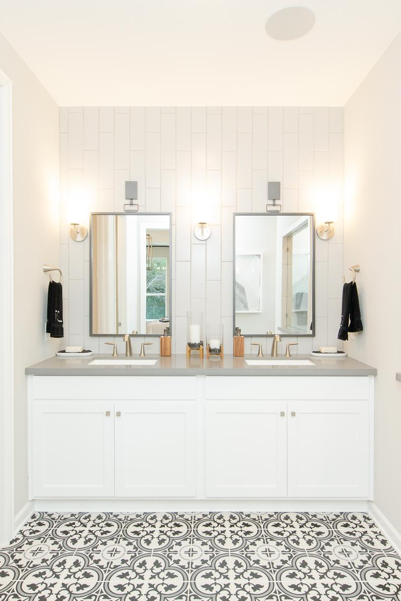 Primary bath with dual vanities and luxe shower