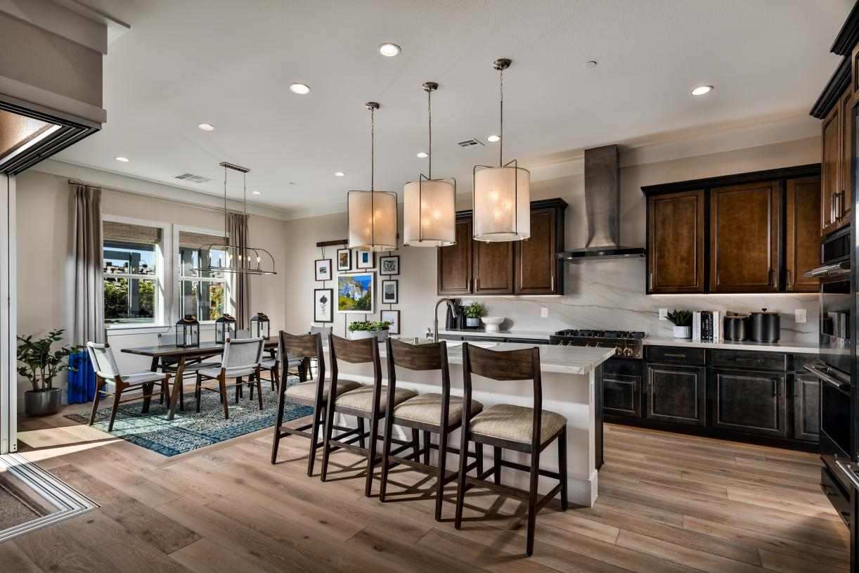 Well-appointed kitchen overlooks a sunny breakfast area