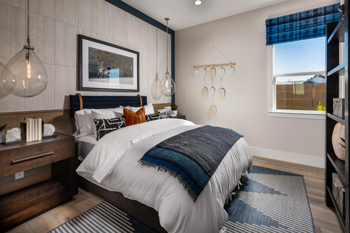 Generous secondary bedrooms feature full baths