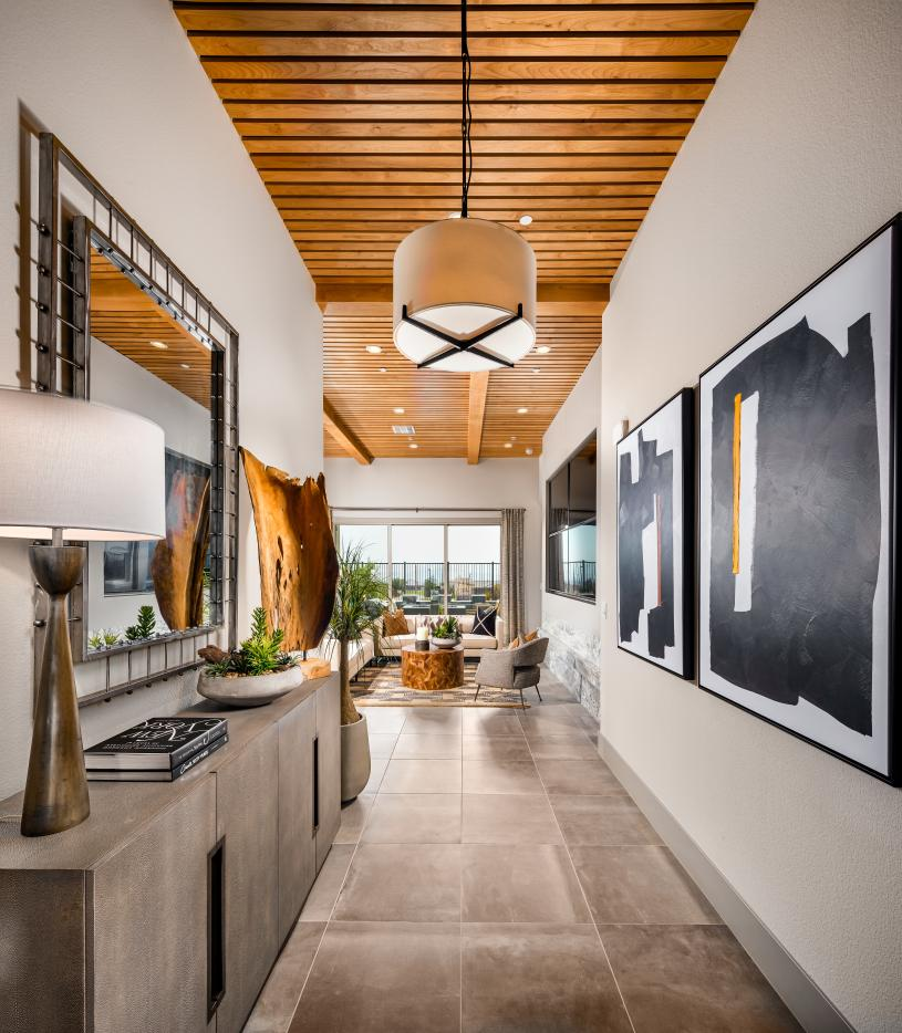 Welcoming foyer entry with views to the great room and desirable covered patio beyond
