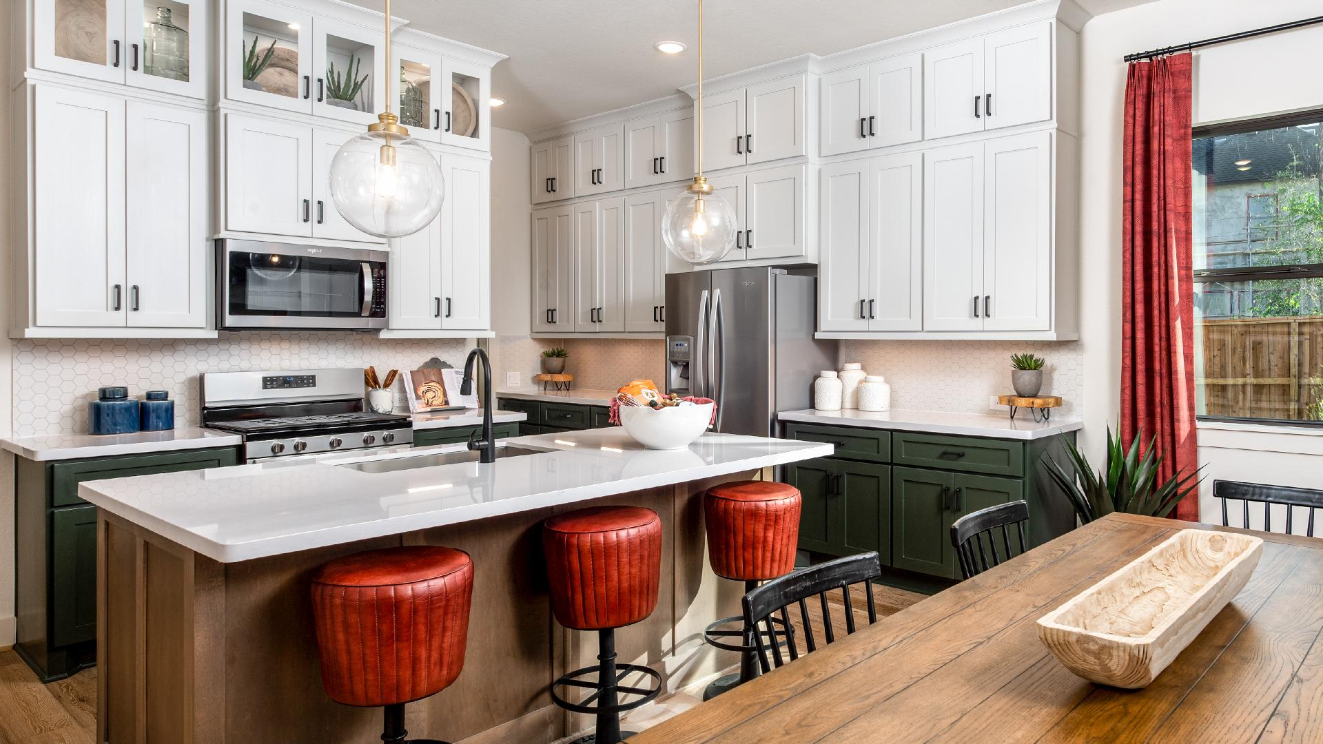 Leighton's well-designed kitchen overlooks a spacious casual dining area