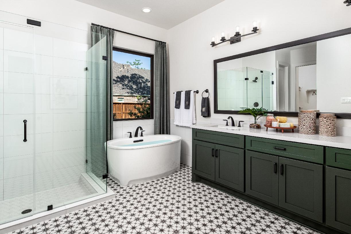 Leighton's spa-like primary bathroom, ideal for rest and relaxation