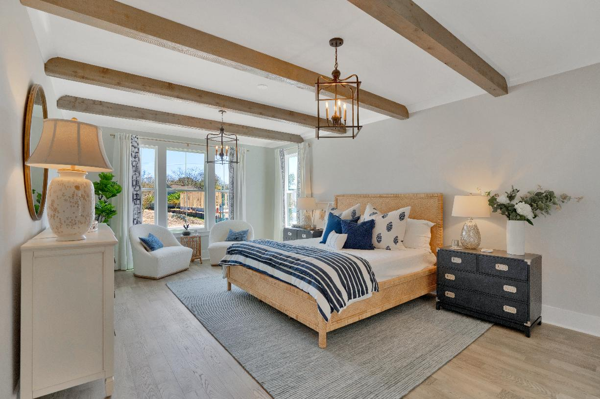 Spacious primary bedrooms with seating areas for relaxation