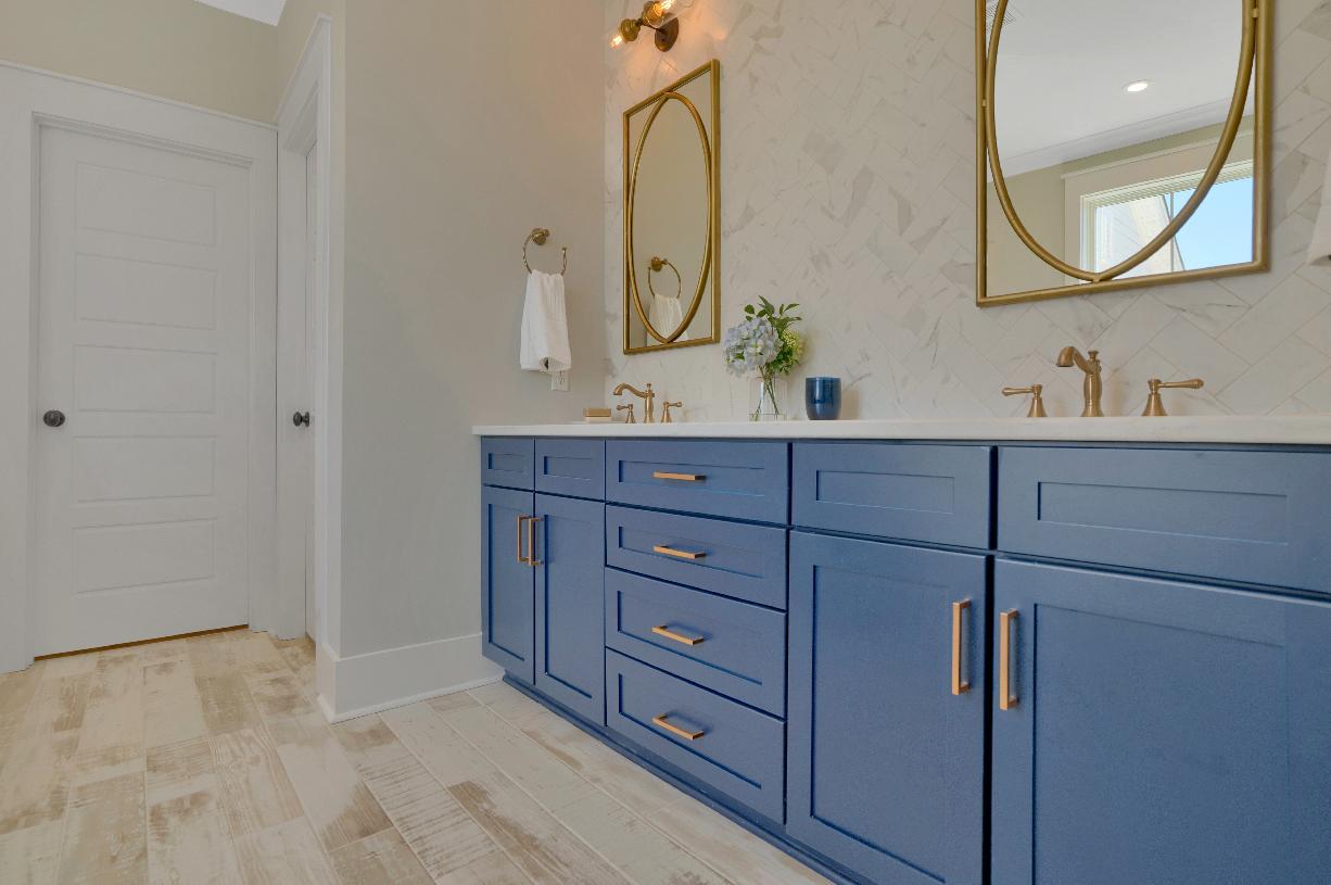 Lavish primary bathrooms with dual-sink vanities