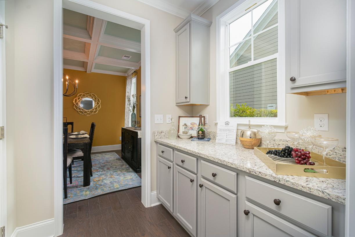 Butler's pantry ideally located off kitchen with ample cabinet space