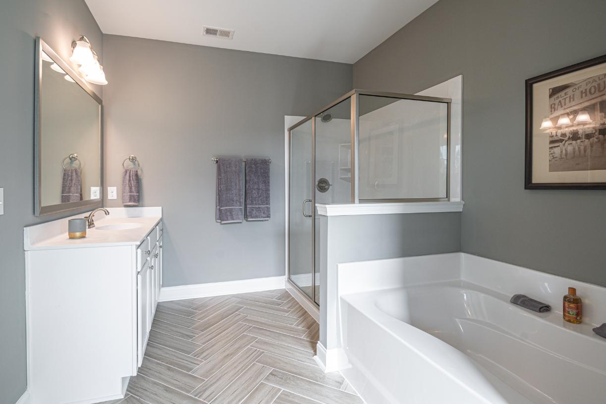 Lavish primary bathrooms with large walk-in shower and large tub