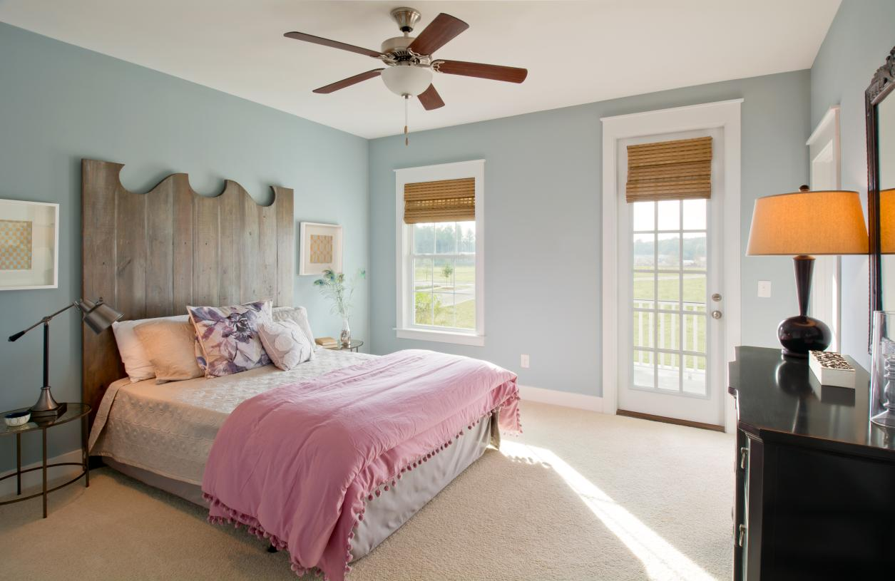 Spacious secondary bedroom suite with access to outdoor balcony